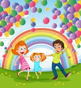 A happy family near the rainbow and balloons